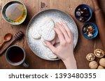 hand holds arabic homemade...   Shutterstock . vector #1393480355