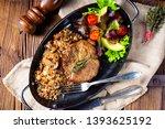 pork steak with mushrooms and...   Shutterstock . vector #1393625192