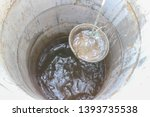 pulling out bucket full of... | Shutterstock . vector #1393735538