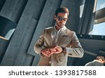 handsome stylish man in beige... | Shutterstock . vector #1393817588
