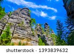 mountain rocks tree tops view.... | Shutterstock . vector #1393839632