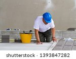 bricklayer at work in building... | Shutterstock . vector #1393847282