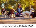 Stock photo walking dogs happy woman dog walker enjoying with dogs 1394049845