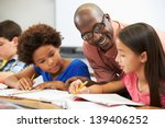 teacher helping pupils studying ... | Shutterstock . vector #139406252
