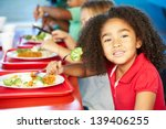 Stock photo elementary pupils enjoying healthy lunch in cafeteria 139406255