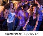 Young Men And Women Dancing In...