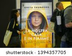 """Small photo of Swedish climate activist Greta Thunberg publish in Italy the book (translated as) """"Our home is burning out"""" Turin Italy May 10 2019"""