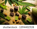cannabis chocolate on wooden... | Shutterstock . vector #1394402528