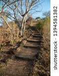 nature hiking trail with stairs ... | Shutterstock . vector #1394581382