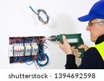 electrician at work in a house | Shutterstock . vector #1394692598