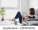 young beautiful woman resting... | Shutterstock . vector #1394993342