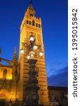 famous tower of giralda ... | Shutterstock . vector #1395015842