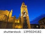 famous tower of giralda ... | Shutterstock . vector #1395024182