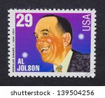 Small photo of UNITED STATES - CIRCA 1994: a postage stamp printed in USA showing an image of Al Jolson, circa 1994.