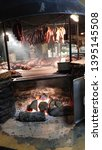 Hanging Meats With Oak Burning