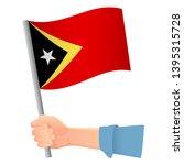 east timor flag in hand.... | Shutterstock .eps vector #1395315728