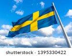 Swedish Flag Against Blue Sky...