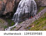 beautiful waterfall girlish... | Shutterstock . vector #1395359585