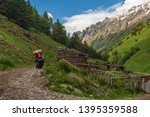 tourist with backpack goes up... | Shutterstock . vector #1395359588