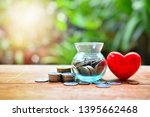 Small photo of money saving set with red heart for concept donation and philanthropy