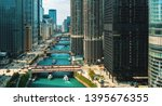 chicago river with boats and... | Shutterstock . vector #1395676355