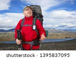 happy tourist with backpack is... | Shutterstock . vector #1395837095