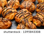 delicious cakes eclairs on the... | Shutterstock . vector #1395843308
