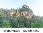 closeup mount top on a blue sky ... | Shutterstock . vector #1395854852