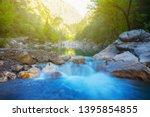 blue mountain river rushing... | Shutterstock . vector #1395854855