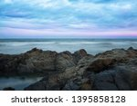 stormy ocean and stony shore on ... | Shutterstock . vector #1395858128