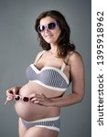beautiful pregnant woman on a...   Shutterstock . vector #1395918962