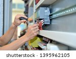 the electrician is connecting... | Shutterstock . vector #1395962105