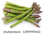 fresh asparagus isolated on... | Shutterstock . vector #1395995432