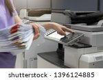 bussinesswoman using copier... | Shutterstock . vector #1396124885