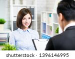 confident asian woman talk to... | Shutterstock . vector #1396146995