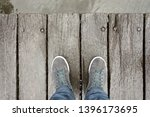 male feets with shoes standing... | Shutterstock . vector #1396173695