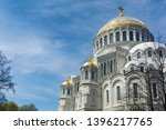 The Kronstadt naval Cathedral of St. Nicholas on the background of the expressive spring sky. Kronshtadt. St. Petersburg Russia