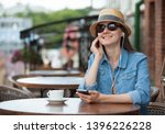 charming young woman with a cup ... | Shutterstock . vector #1396226228