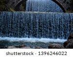 double waterfalls of... | Shutterstock . vector #1396246022