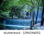 double waterfalls of... | Shutterstock . vector #1396246052