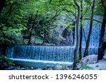 double waterfalls of... | Shutterstock . vector #1396246055