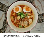 Spicy Noodles Soup With Eggs  ...