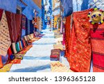 street with souvenirs in... | Shutterstock . vector #1396365128