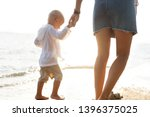 mother playing with her son at... | Shutterstock . vector #1396375025