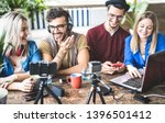 Young happy friends sharing content on streaming platform with digital web camera - Modern marketing concept with millenial guys and girls having fun vlogging live feeds on social media network - stock photo