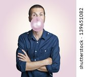 young man blowing a pink bubble ... | Shutterstock . vector #139651082