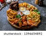assorted beer snacks. onion... | Shutterstock . vector #1396654892