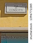 Small photo of Via Dei Condotti street sign in Rome. Bottom sign of the Louis Vuitton boutique. Rome Italy. 05/02/2019. Via Via Dei Condotti street sign in Rome.