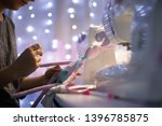 a young woman sews a rag bunny... | Shutterstock . vector #1396785875