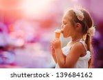 on seacoast the girl eats ice... | Shutterstock . vector #139684162